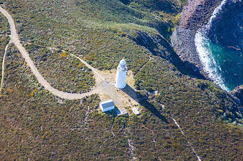 The Cape Bruny Lighthouse on the sea cliff coastline