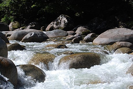 Mossman river flowing over granite boulders