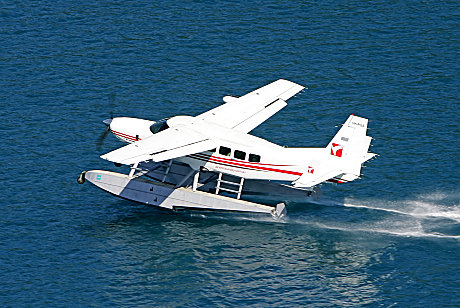 Experience a seaplane landing on the ocean