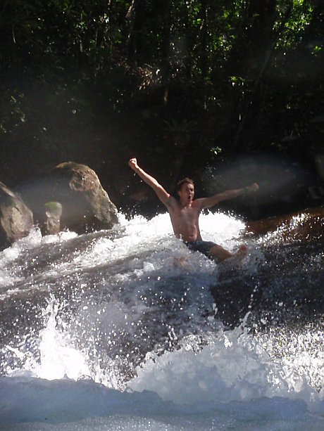 Slide down a natural water slide at Josephine Falls!
