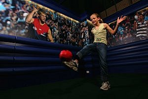 AFL World kicking girl