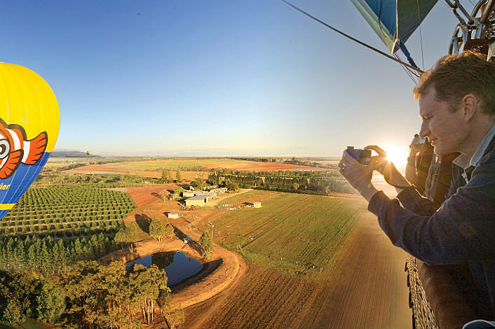 Taking photos from Balloons over Atherton Tablelands