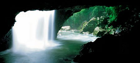 Water cascades into the Natural Bridge cave