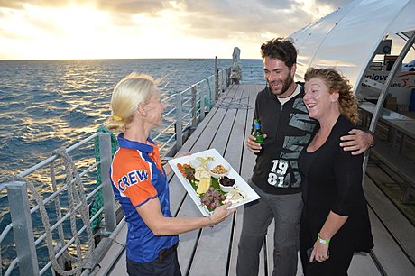 Witness the sunset over the Great Barrier Reef and enjoy canapes