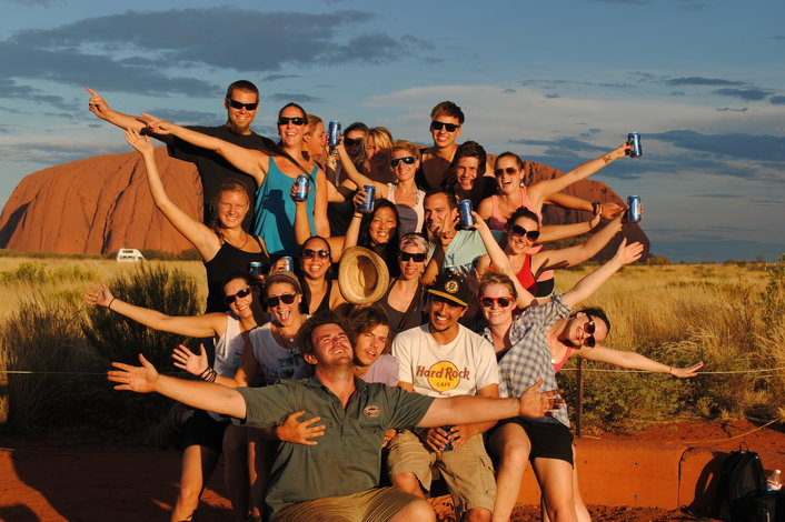Happy Campers enjoying Uluru Sunset with the tour guide