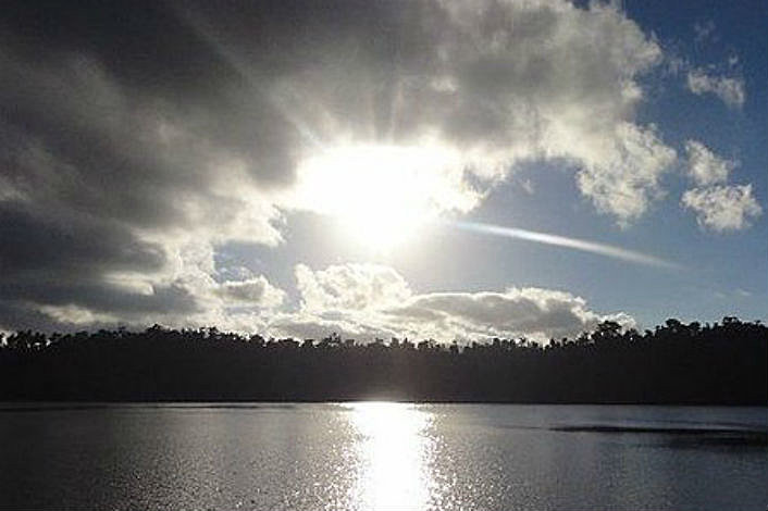 Afternoon sun over Lake Eacham