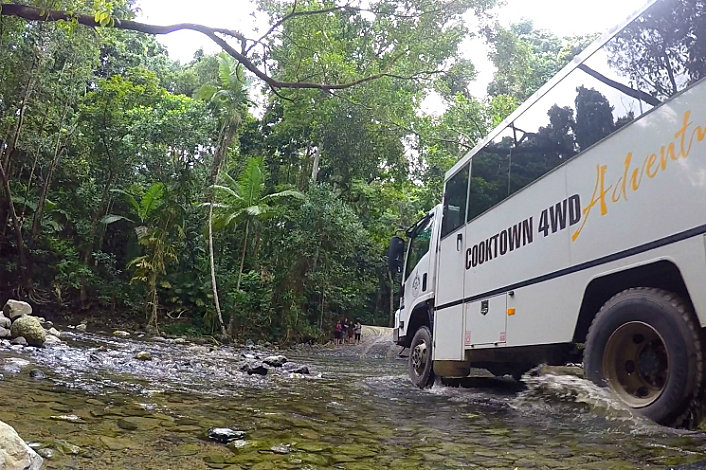 4wd Bus crossing a river in the Daintree