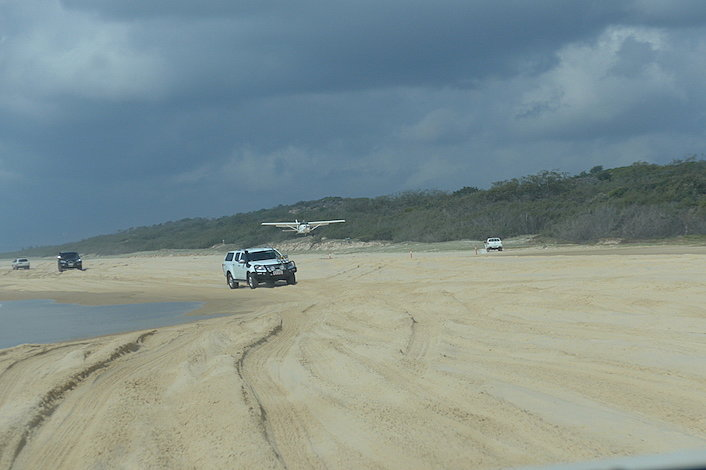 Plane landing on 75 Mile Beach