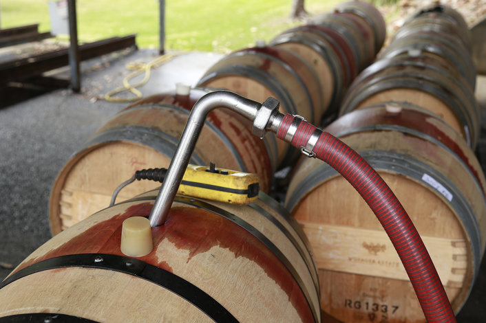pumping wine into the barrels