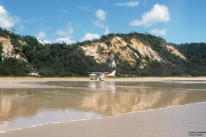 Plane landing on Beach at Fraser Island