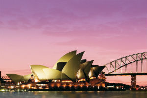 the Sydney Opera House and Harbour Bridge in a purple sunset