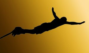 A Bungy jumper 'Flying' with the sun behind them