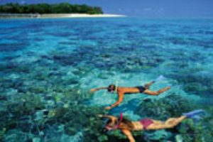 Couple snorkelling off Green Island