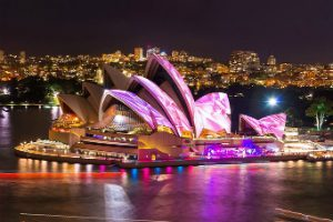Sydney Opera House with pink light painting her sails