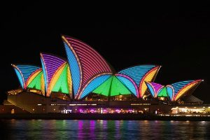 Different coloured lights on the sails of Sydney Harbour bridge VIVID