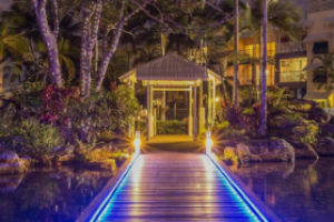 night time view over the lagoon pool at Coral sands Trinity beach