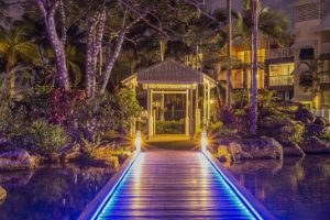 Blue lit boardwalk at Coral Sands trinity Beach