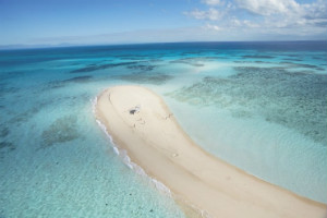 A sand cay stretching out into the Great Barrier Reef