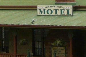 Sign on the roof of the curtain fig motel at yungaburra