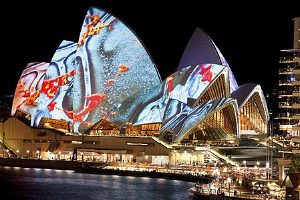 Sails of Sydney Opera House bathed in light during Vivid