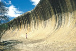person standing at the Bottom of Wave rock WA