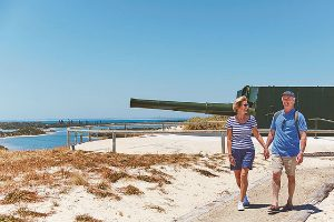 Couple walking along the Military Installation at rottnest island