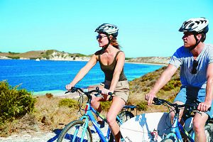 A couple bike riding on rottnest Island near Perth