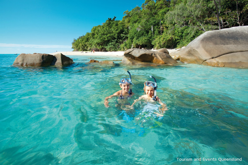 two children Snorkelling off Nudey beach Fitzroy Island
