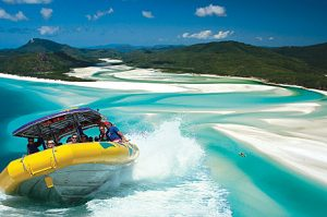Image of Whitehaven Beach and the raft boat