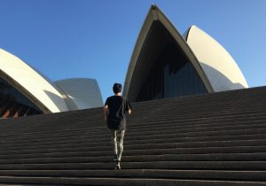 Person jogging up the steps of the Opera House