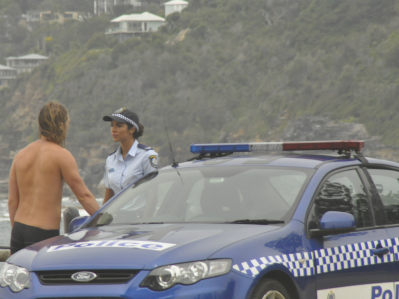 Police Officer Talking to Surfer at Summer Bay