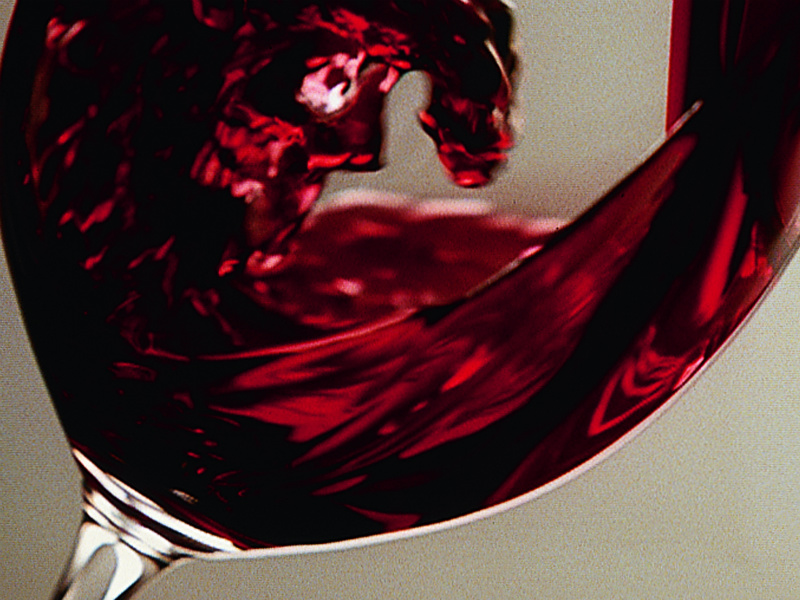 Image of red wine swirling in a glass