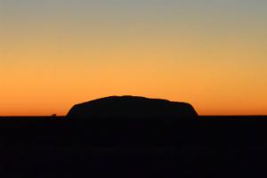 A silhouette of Uluru