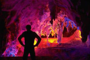 Coloured lights illuminatin Jenolan Caves