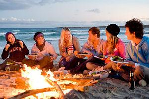 A group sitting around a campfire on Kangaroo island