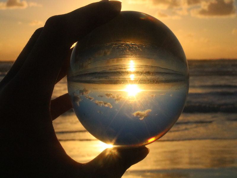 Abstract photo taken of sunrise looking through crystal ball