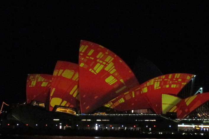 Light projections in red & yellow on the Sydney Opera House